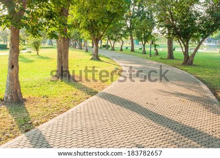 Jogging track at green garden - stock photo