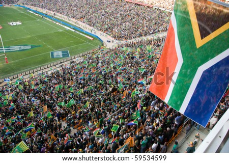 JOHANNESBURG - AUGUST 21: The South African flag at the FNB Stadium in Soweto on August 21, 2010.  The game set the record for the highest attendance at a South African Rugby match. - stock photo