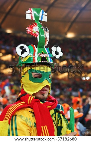 JOHANNESBURG - JULY 11 :  Final at Soccer City Stadium: Spain vs. Netherlands on July 11, 2010 in Johannesburg.  Spanish supporter - stock photo