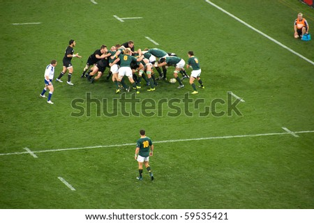 JOHANNESBURG, SOUTH AFRICA - AUGUST 21: The South African National Rugby team defends the New Zealand All Blacks on August 21 2010. NZ beat SA by 29 points to 22 to win the 2010 Tri-Nations. - stock photo