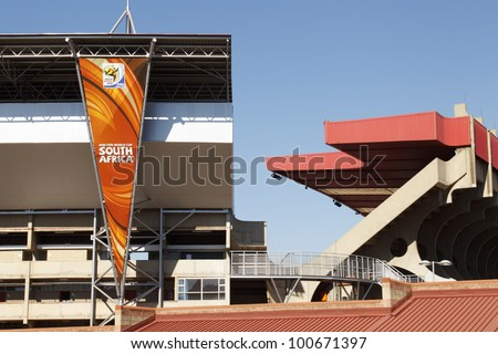 JOHANNESBURG, SOUTH AFRICA - JUNE 21:  A banner hangs outside Ellis Park Stadium in Johannesburg, South Africa on June 21, 2010 ahead of a FIFA World Cup soccer match. - stock photo