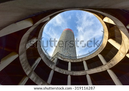 Johannesburg, South Africa - May 25, 2015: Ponte City Building, looking upwards. Ponte City is a famous skyscraper in the Hillbrow neighbourhood of Johannesburg. - stock photo