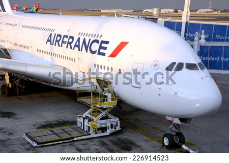 JOHANNESBURG SOUTH AFRICA OCTOBER 20: Air France A380 a the Johannesburg's airport in preparation for takeoff on october 20 2014 in Johannesburg SA. A380 is the world's largest passenger airliner - stock photo