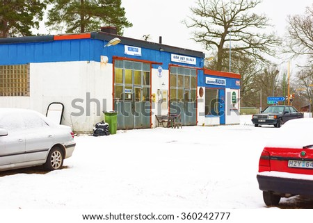 JOHANNISHUS, SWEDEN - JANUARY 8, 2016: The auto repair shop houses a garage and a do it yourself car wash. Snow outside and closed doors.  - stock photo