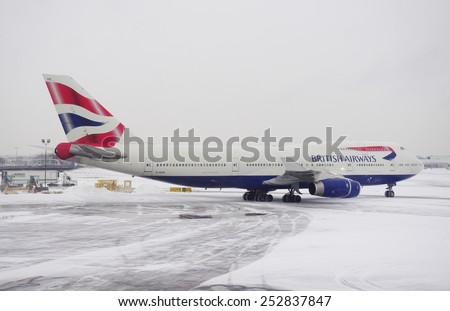 JOHN F. KENNEDY AIRPORT, NEW YORK  9 JANUARY 2015 A Boeing 747 plane from British Airways (BA) is getting ready for take-off after a winter snowstorm at John F. Kennedy International Airport (JFK). - stock photo
