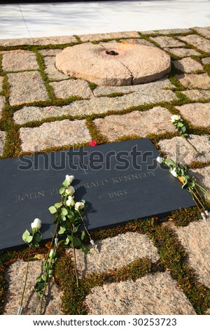John F Kennedy eternal flame grave site in Arlington National Cemetery in Virginia - stock photo