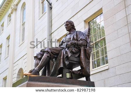 John Harvard statue in Harvard University in Cambridge, Massachusetts, USA - stock photo