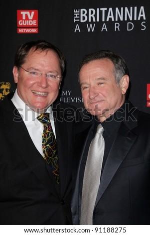 John Lasseter, Robin Williams at the BAFTA Los Angeles 2011 Britannia Awards, Beverly Hilton Hotel, Beverly Hills, CA 11-30-11 - stock photo