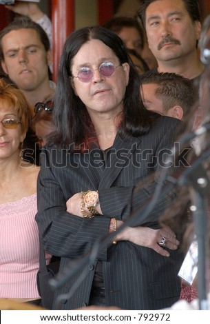 "John ""Ozzy"" and Sharon Osborn at the honoring of the late Randy Rhoads  to the Hollywood Rock Walk of Fame, Los Angeles, Ca, 03/19/04 - stock photo"