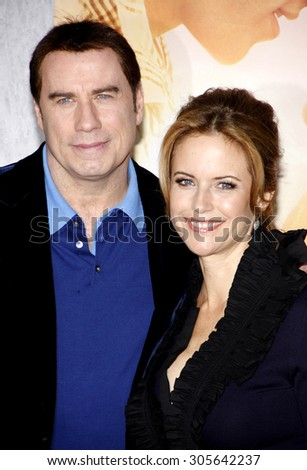 John Travolta and Kelly Preston at the Los Angeles premiere of 'The Last Song' held at the ArcLight Cinemas in Hollywood, USA on March 25, 2010. - stock photo