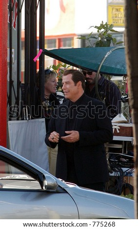 "John Travolta at the filming of his new movie ""Be Cool"", Hollywood, Ca, 03/17/04 - stock photo"
