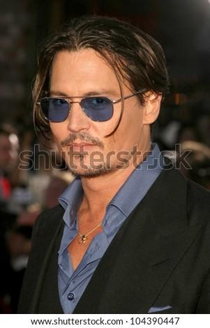 Johnny Depp at the Los Angeles Premiere of 'Public Enemies'. Mann Village, Westwood, CA. 06-23-09 - stock photo