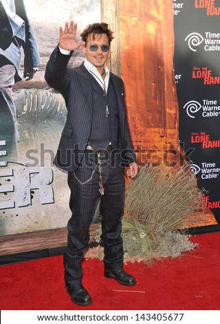 """Johnny Depp at the world premiere of his new movie """"The Lone Ranger"""" at Disney California Adventure. June 22, 2013  Anaheim, CA - stock photo"""