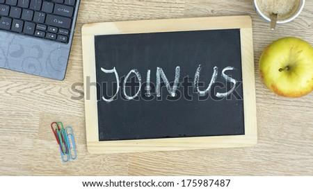 Join us written on a chalkboard at the office - stock photo