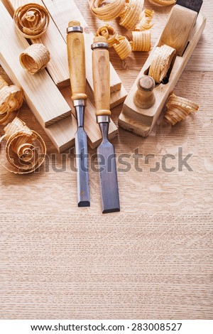 joiners tools woodworkers plane carpentry chisels boards and shavings  - stock photo