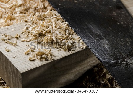 joinery tools - a saw blade on wooden table - stock photo