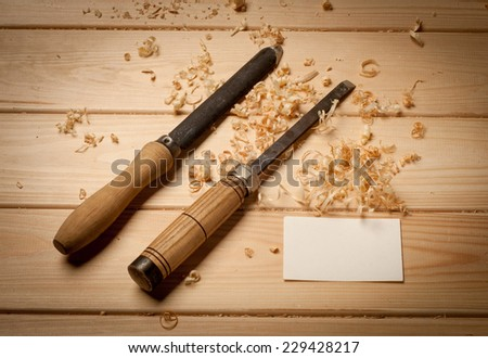 joinery tools on wood table background with business card and copy space - stock photo