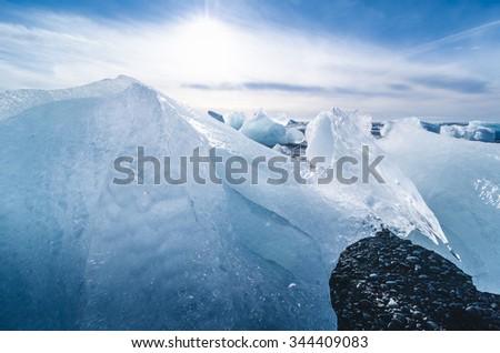 jokulsarlon beach with icebergs, iceland - stock photo