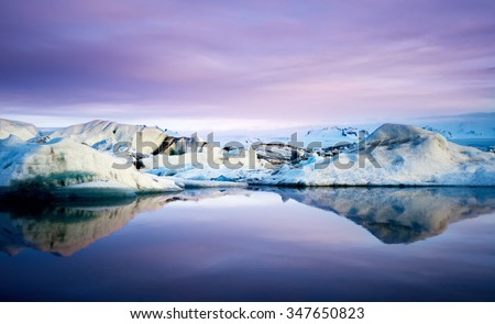 Jokulsarlon glacier Lagoon with floating icebergs and reflection in southeast iceland, a famous natural tourist attraction - stock photo