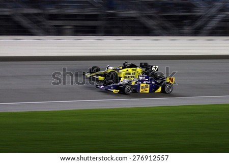 Joliet Illinois, USA - August 29, 2009: IndyCar Racing League. Nighttime Race action on track, cars running wheel to wheel, Chicagoland speedway. - stock photo