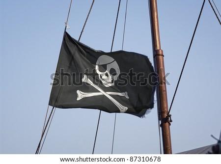 Jolly Roger skull and crossbones black pirate flag - stock photo