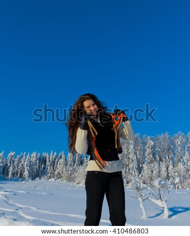 Jolly Winter Girl and Sparkling Snowy Trees  - stock photo