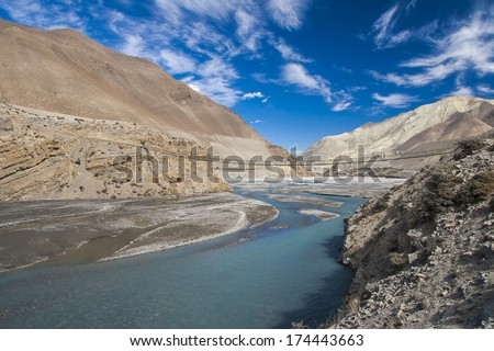 JOMSOM, NEPAL - CIRCA NOVEMBER 2013: Kali Gandaki is a river in Nepal and India, a left tributary of the Ganges circa November 2013 in Jomsom. - stock photo