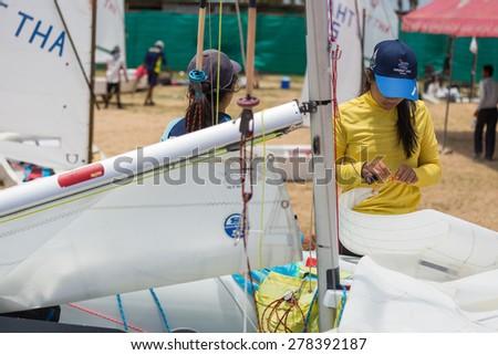 JOMTIEN, THAILAND - MAY 01 : Unidentified racer preparing her Optimist ship in Top of the Gulf Regatta event at Jomtien beach Pataya May 01, 2015 - stock photo