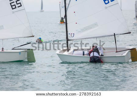JOMTIEN, THAILAND - MAY 01 : Unidentified racer reaching her boat in Top of the Gulf Regatta event at Jomtien beach Pataya May 01, 2015 - stock photo