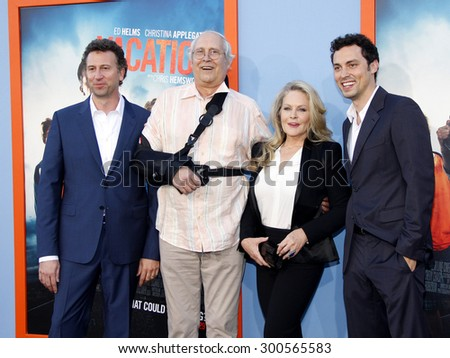 Jonathan Goldstein, John Francis Daley, Chevy Chase and Beverly D'Angelo at the Los Angeles premiere of 'Vacation' held at the Regency Village Theatre in Westwood, USA on July 27, 2015. - stock photo