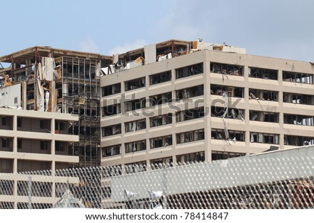 JOPLIN, MISSOURI - MAY 22: St. John's Medical Center vows to rebuild after widespread destruction of their facilities and nearby medical offices by a massive EF5 Tornado in Joplin, Missouri on May 22, 2011 - stock photo