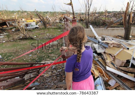 JOPLIN, MO - MAY 22: The killer EF-5 tornado which caused extensive damage and 160 deaths forever changed the lives of young and old alike who experienced the devastation. May 22, 2011, Joplin, Mo - stock photo