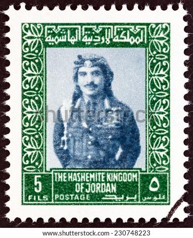 JORDAN - CIRCA 1975: A stamp printed in Jordan shows King Hussein, circa 1975.  - stock photo