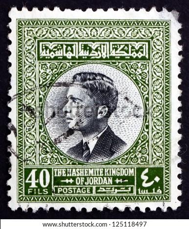 JORDAN - CIRCA 1959: a stamp printed in the Jordan shows King Hussein, King of Jordan, circa 1959 - stock photo