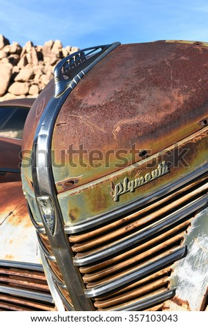 JOSHUA TREE, CALIFORNIA - JANUARY 1, 2016: Plymouth Grill. The front end of a rusted old Plymouth at Keys Ranch in Joshua Tree National Park. - stock photo