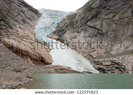 Jostedal glacier falls in to fjord,  Norway, Scandinavia, Europe - stock photo