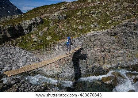 JOTUNHEIMEN, NORWAY-JULY 7: Trackers July 7, 2016 in Jotunheimen, Norway. Trackers in the mountains. - stock photo