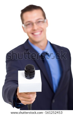 journalist with microphone interviewing isolated on white background - stock photo