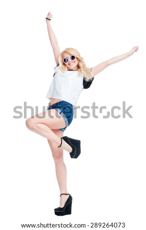 Joy and youth. Winner girl. Happy beautiful young woman raised her arms up. Isolated on white. - stock photo