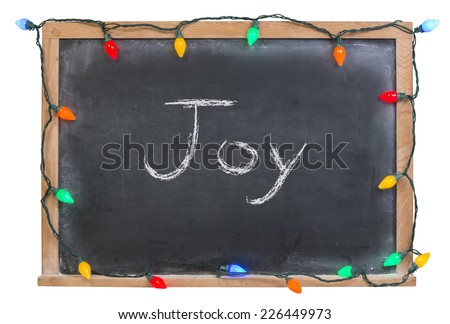 Joy written in white chalk on a black chalkboard surrounded with colorful lights isolated on white - stock photo