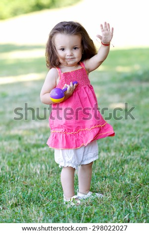 Joyful and happy child playing in the garden - stock photo