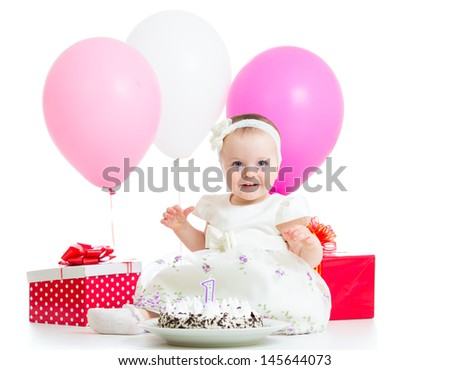 Joyful baby girl with cake, balloons and gifts. Isolated on white. - stock photo