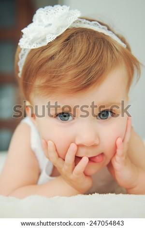 joyful baby showing tongue - stock photo