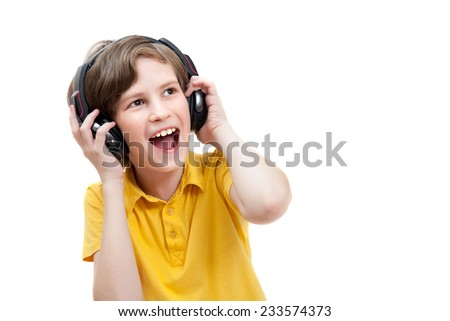 Joyful boy listens music with headphones, isolated on white background - stock photo