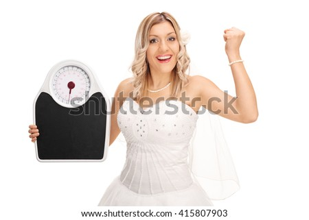 Joyful bride holding a weight scale and gesturing happiness isolated on white background - stock photo