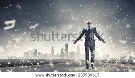Joyful businessman with outstretched arms celebrating success - stock photo