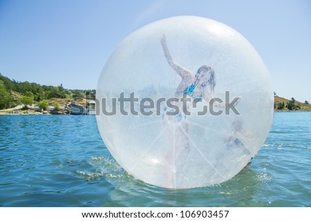 Joyful children in a balloon floating on water. - stock photo