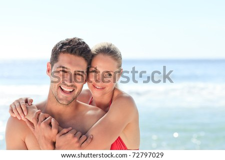 Joyful couple at the beach - stock photo
