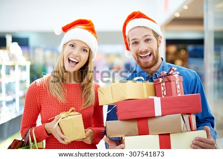 Joyful couple going shopping for Christmas - stock photo
