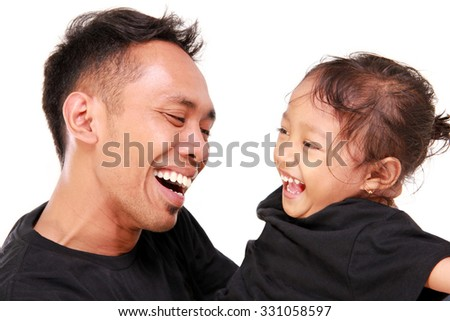 Joyful faces of young Asian father and her daughter laughing together, close up portrait, isolated on white background - stock photo